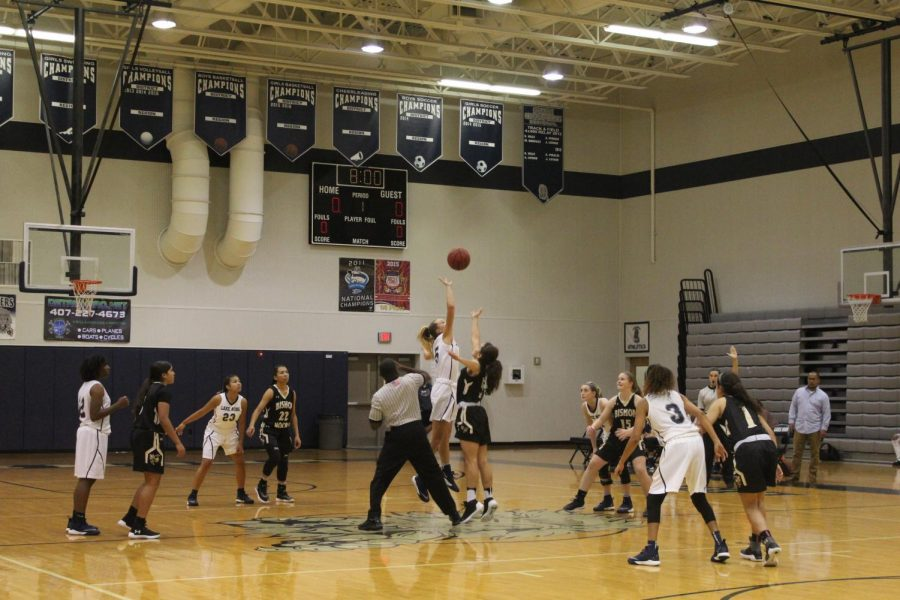 Lake Nonas Stephanie Towle (10) tips off against Bishop Moore
