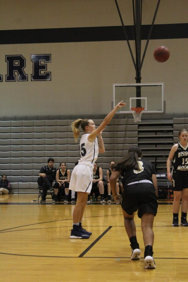 Stephanie Towle (10) shooting a free throw against Bishop Moore