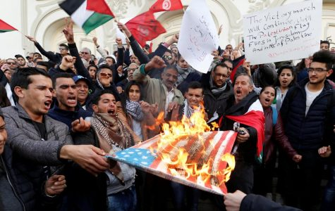 In Tunis, Tunisia. protesters burned US flags and called for Palestinian control of Jerusalem.  Photo By Zoubeir Souissi/Source: Reuters