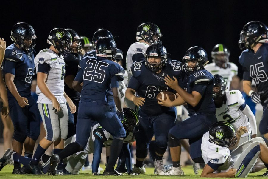 Defense puts on a show against Windermere as Javier Gratacos (11) comes up with a fumble.
