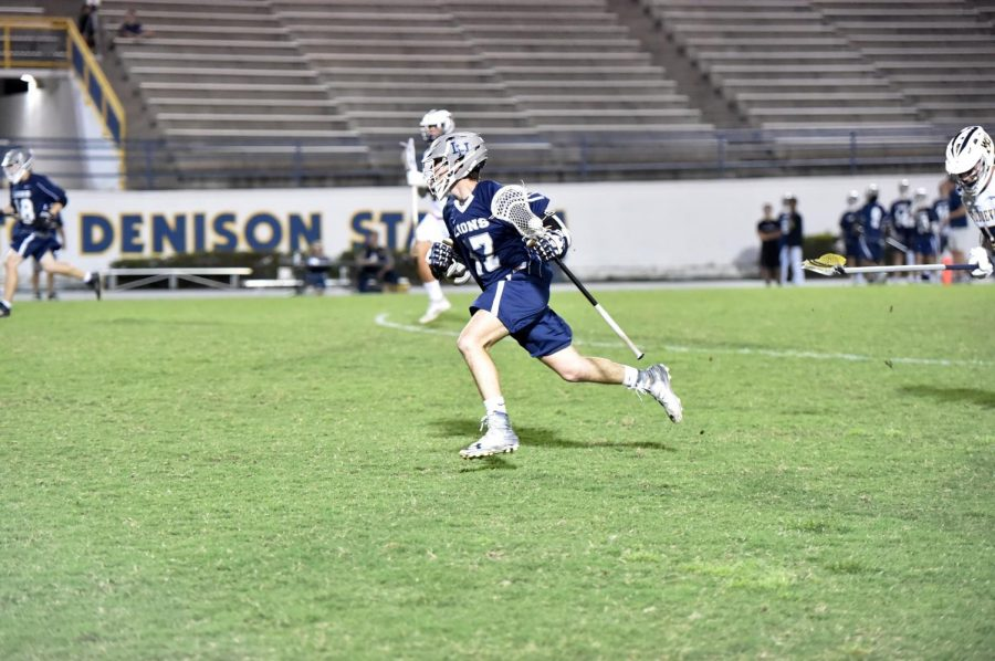 #17, Brady Ragsdale running the ball down the field for a goal.