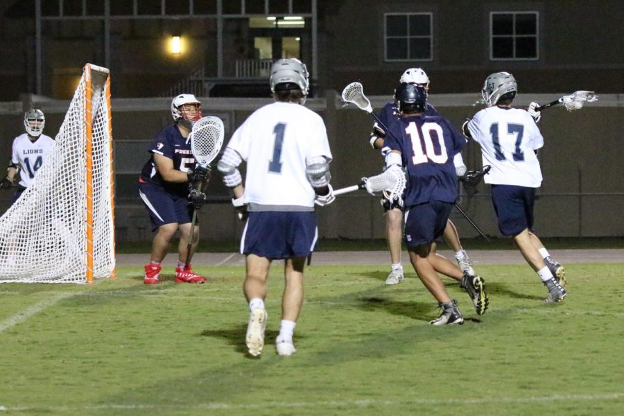 Senior #17, Brady Ragsdale shoots and scores against Freedom on Monday the 25th.