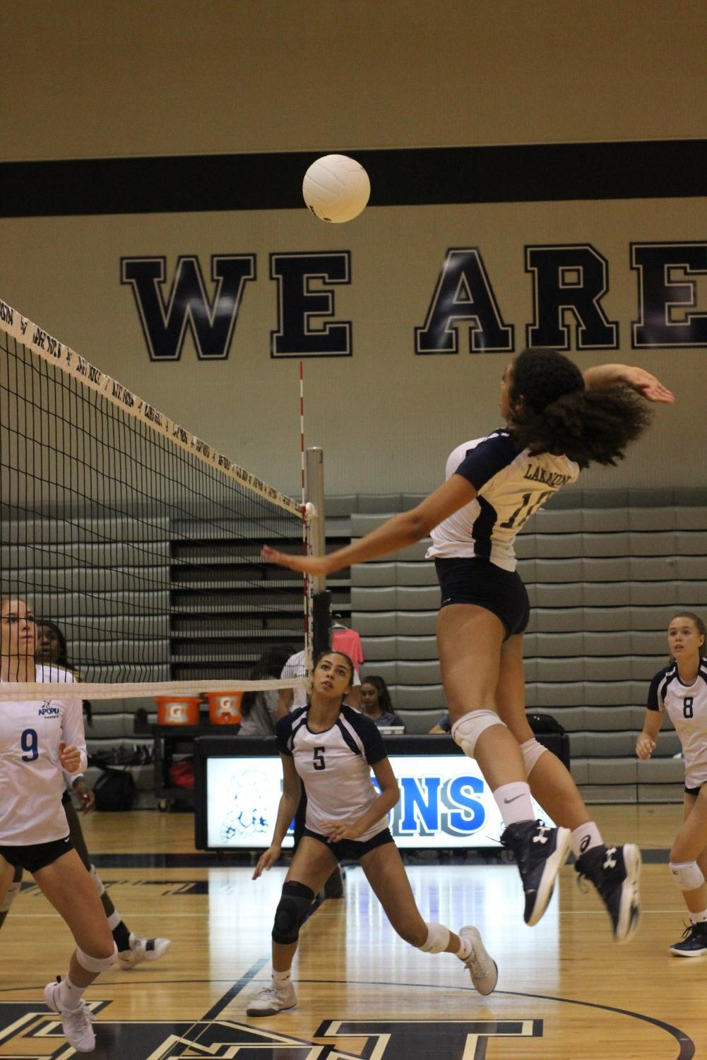 Zoe Glover (11) spikes the ball and adds another point to the Lion's pocket against Apopka.