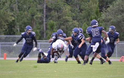 Varsity Football Dominates Against Colonial