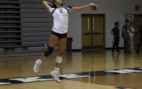 Nyah Molina (11) serves against Apopka