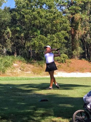 Girls Golf Makes it a Struggle to Keep Up