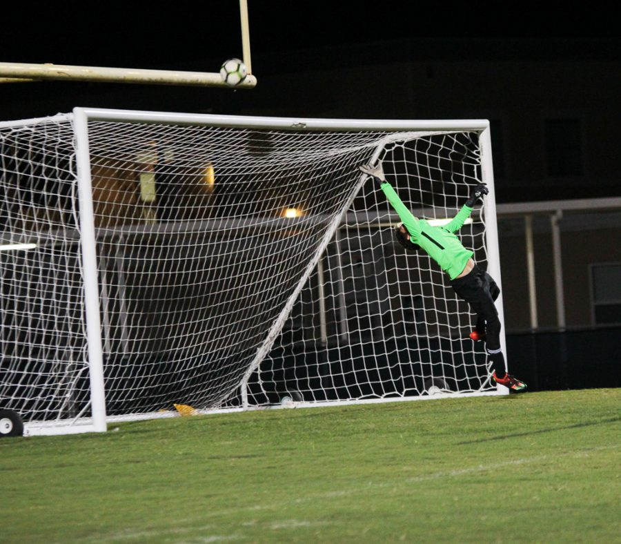 Sebastian Maldonado (9) saves a potential goal from the Highlanders.