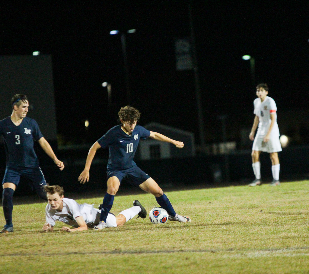 Alejandro Flores Valentin (12) steals the ball from Seminole player, leaving him on the ground.