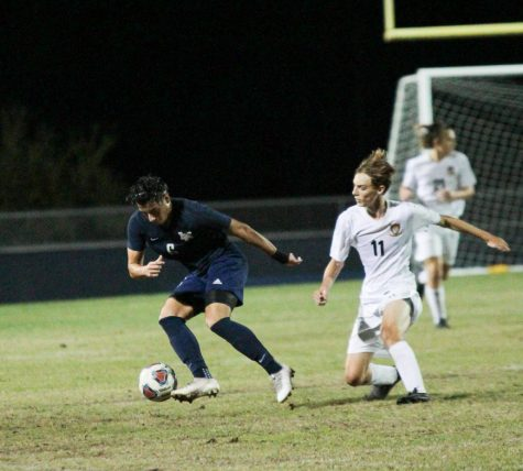 Camilo Rincon (12) does a  quick move to get past Seminole defender.