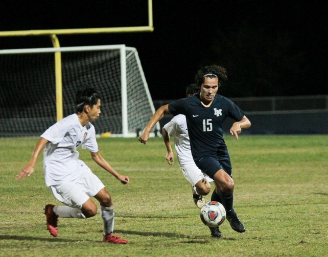 Alejandro Arvelo (10) dribbles the ball through Seminole defender.