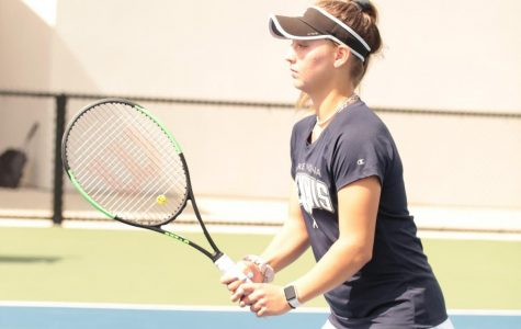 Paige Hermans (11) sets up for a return during the line No.1 doubles match.