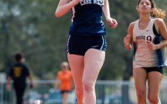 Navigation to Story: Girls Track Metro East Conference