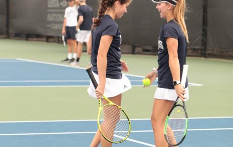 Paige Hermans and Patricia Gonzalez congratulate each other on a big 8-0 win for their doubles match.