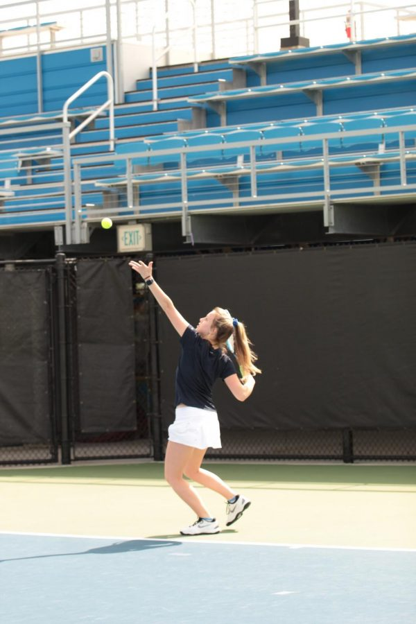 Sarah+Holditch+serves+the+ball+during+her+8-1+win.+